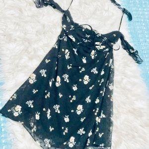 Black floral print mini dress.